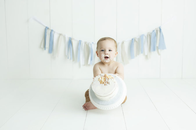 one year old boy cake smash light blue gingham and tan Peter rabbit
