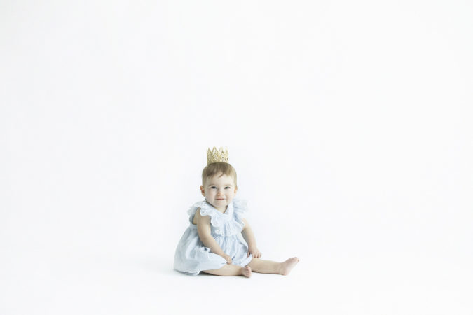 one year old girl blue dress gold crown