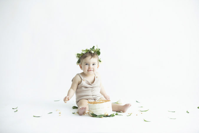 one year old girl cake smash naked cake green wreath