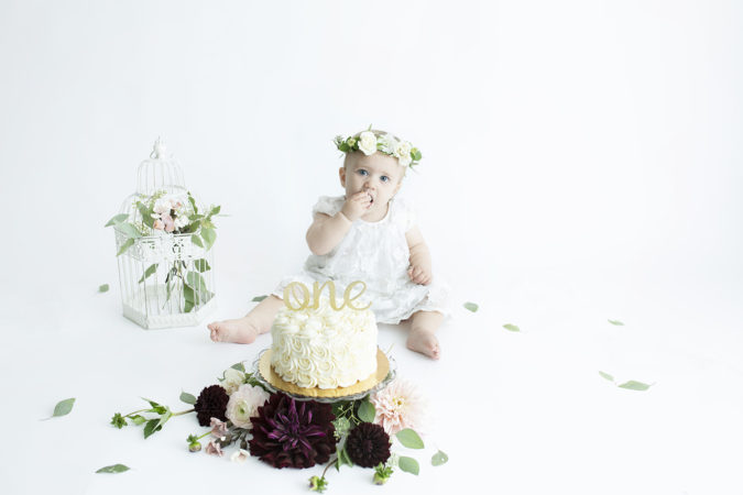 one year old girl cake smash fresh flowers crown burgundy