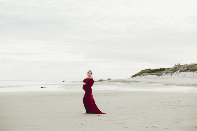 pregnant mother wearing red gown maternity session beach low tide