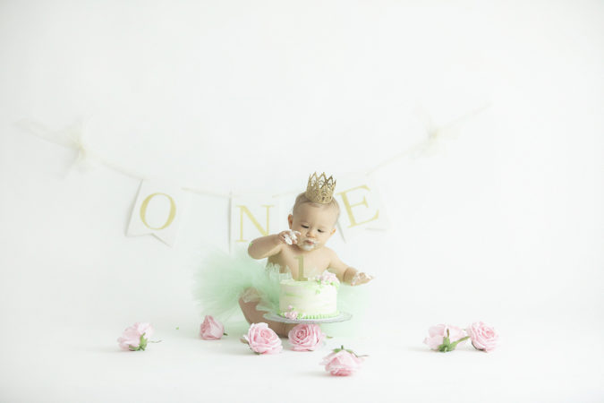 first birthday cake smash little girl mint green tutu gold crown pink flowers one banner