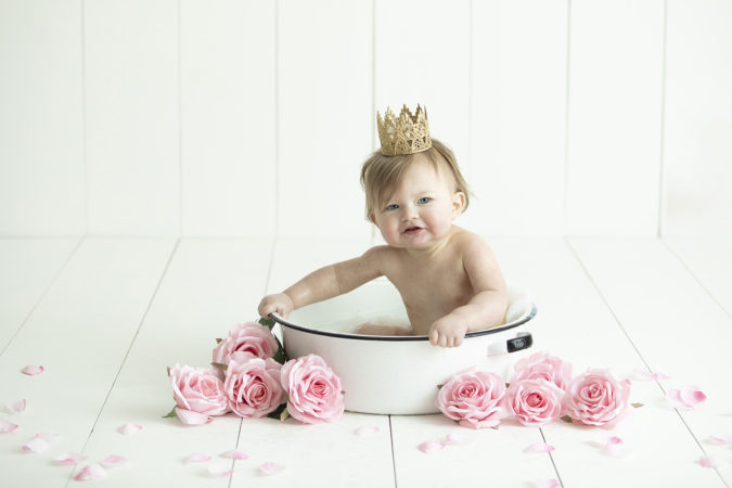 first birthday milk bath little girl with gold crown pink flowers