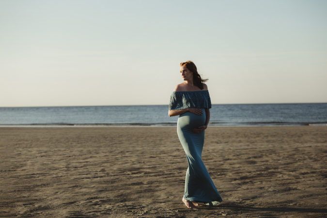 outdoor maternity session blue dress woman with red hair